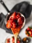 Strawberry Compote on a wooden spoon