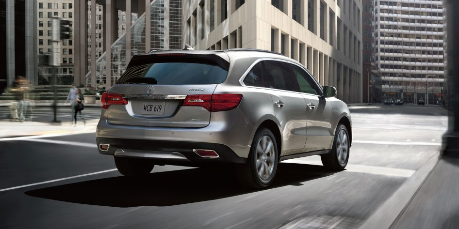 2014-mdx-exterior-sh-awd-with-advance-package-and-accessories-in-silver-moon-pointed-building-5_hires