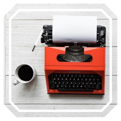 red typewriter and coffee