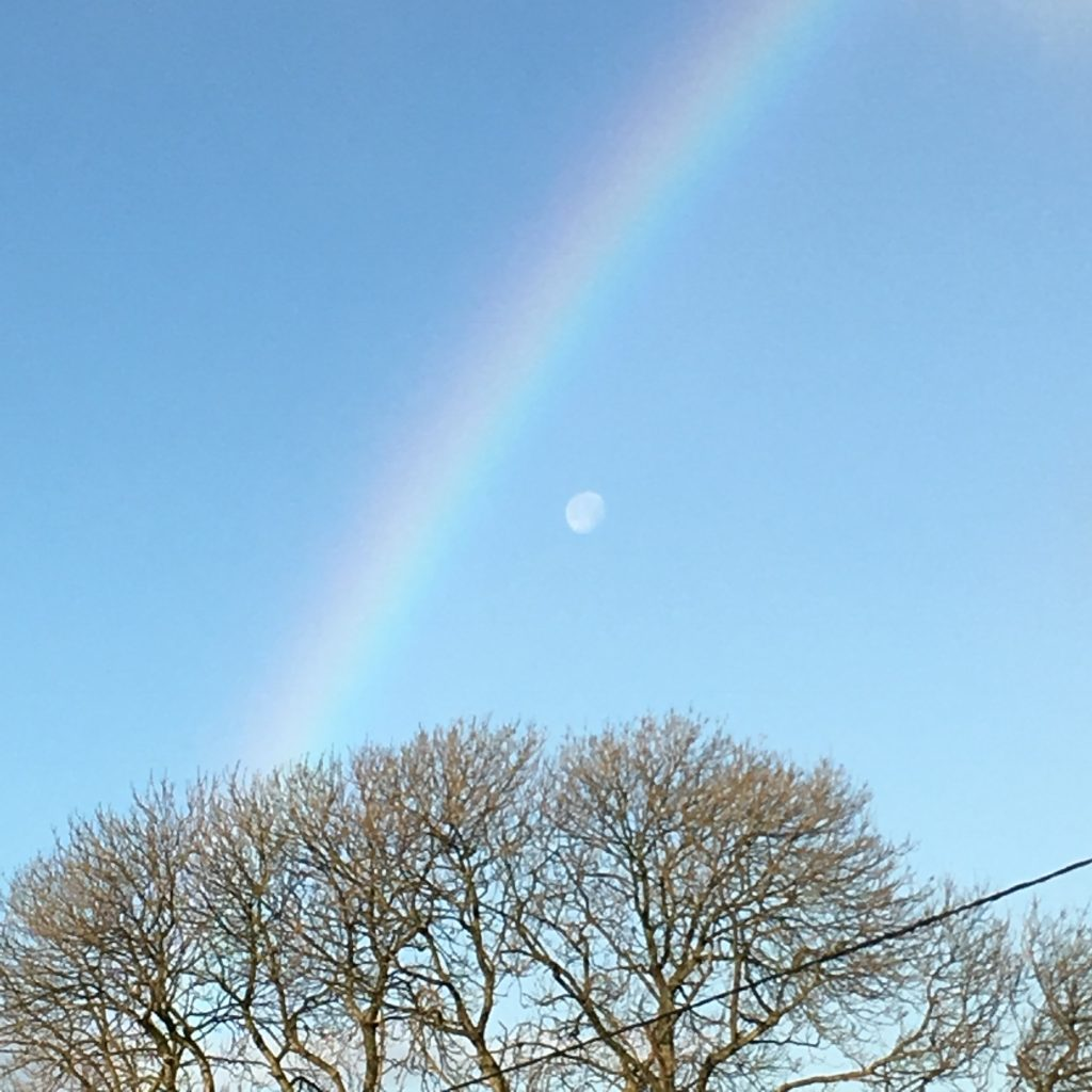 moon and rainbow observed together