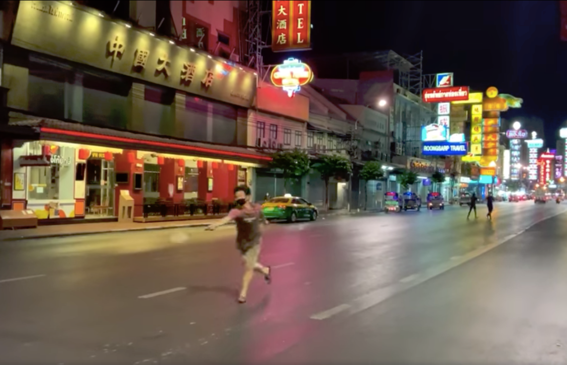A man played badminton to prove how quiet Yaowarat road was during COVID-19