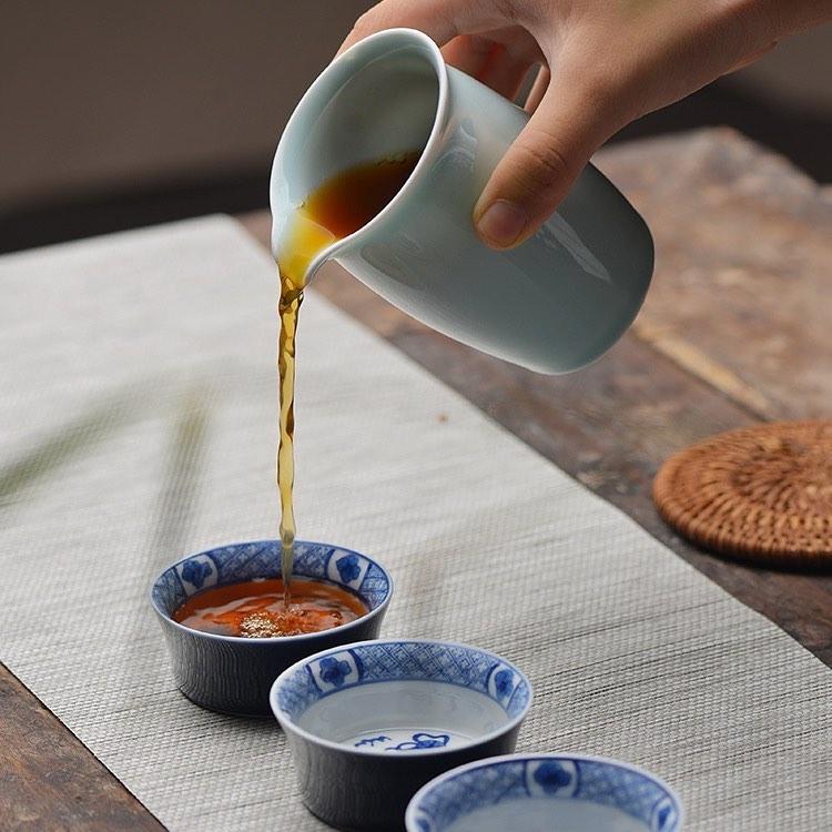 Pouring tea into tea cup