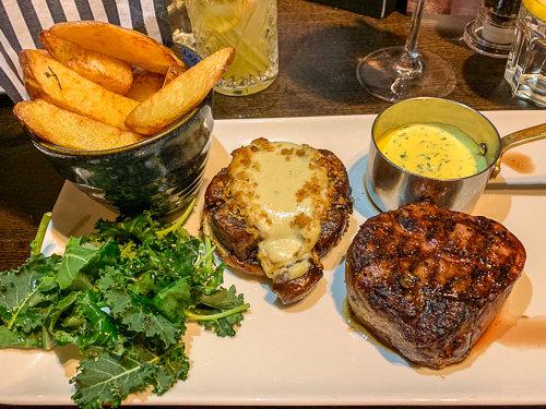 7oz steak served with chunky chips, kale and an ale glazed shallot tart
