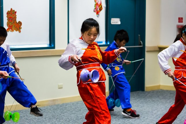 Students from the Fremont Chinese School perform with Chinese yo-yos on Saturday at the Chinese New Year celebration at Fremont Main Library. Photo by James Sakane