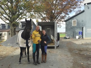 """Equestrian club secretary Lauren Schiel (left) and president Regan McMinn (right) pose with their """"off the track Thoroughbred"""" named Cali. Cali was graciously donated to the team after they were featured  in an article through Lancaster Online. (Photo courtesy of Miranda Snyder.)"""