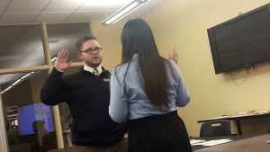 Gloria Chung swears in Kiefer Luckenbill as Student Senate President for the remainder of the semester. Photo courtesy of Mickayla Miller.