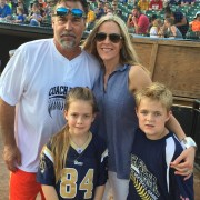 Photo of Coach Jeff Fisher with the Gebel family.