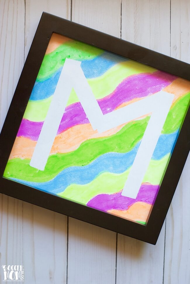 Kids will love creating their initial (or any design) with this easy tape-resist technique! A mess free painting activity for all ages & fun art gift idea!