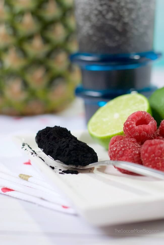 Don't be fooled by the jet-black color, this Charcoal Detox Smoothie is absolutely delicious and bursting with tropical fruit flavors & healthy ingredients!
