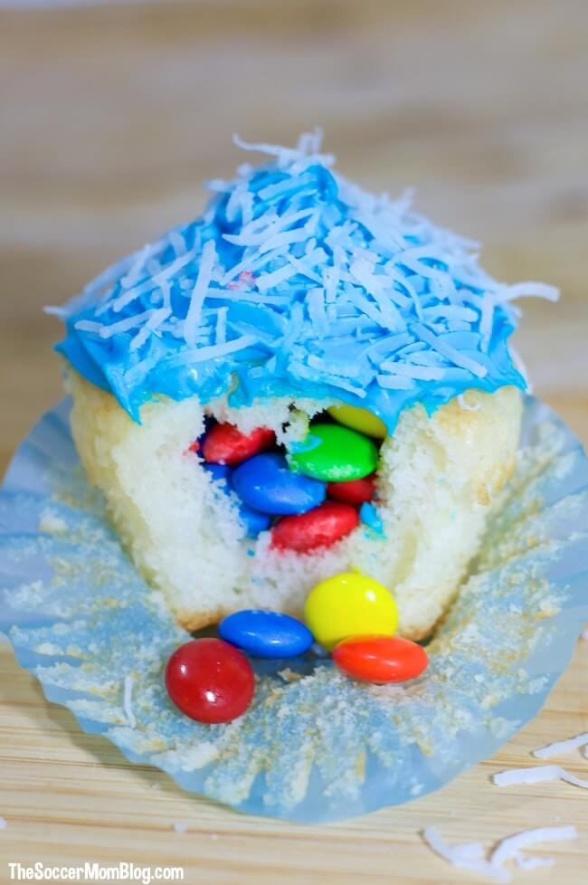 Make your birthday superstar's special day even more magical with these fun & festive piñata cupcakes! A super easy kids party recipe they'll LOVE!