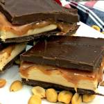 This recipe for homemade peanut butter Snickers bars takes an all-time favorite candy to the next level of amazingness! Layers of ooey-gooey goodness!!