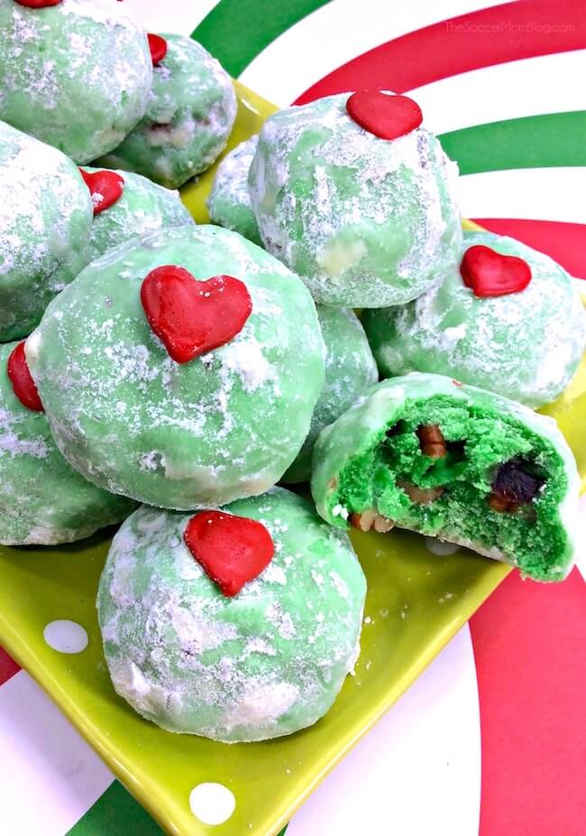 So festive even the grumpiest of grinches will have to smile! These Grinch Snowball Cookies are a colorful twist on a classic Christmas treat!