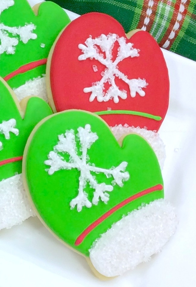 These Christmas mitten sugar cookies are almost too cute to eat!! A gorgeous holiday recipe perfect for parties, teacher gifts, or for Santa!