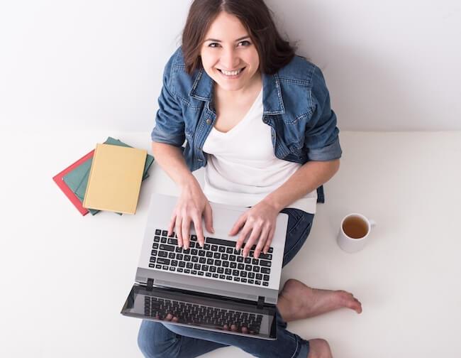 mom blogger on laptop smiling