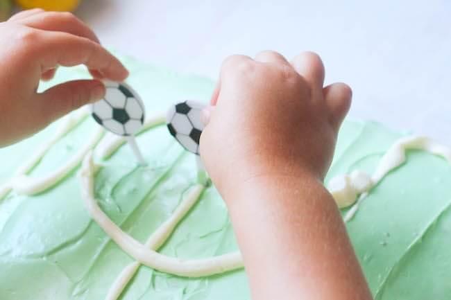 Decorating a soccer birthday cake