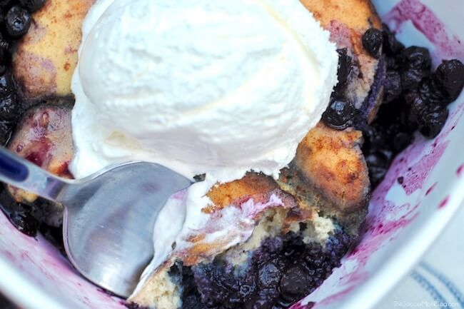 Close up of cake style blueberry cobbler in bowl