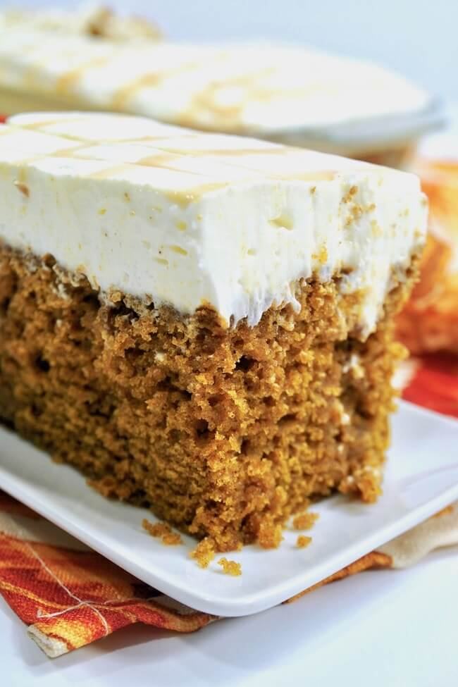 The perfect poke cake! This dreamy pumpkin poke cake is soaked with rich caramel and topped with a fluffy whipped cream cheese frosting.