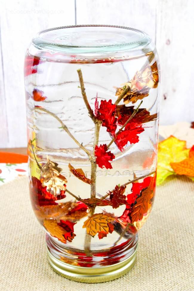 Who says snow globes are just for winter?? This Falling Leaves Sensory Bottle is a cute and easy Fall kids craft or decor idea!