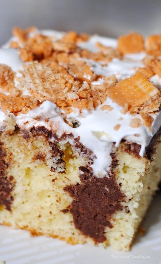 WOW! Rich butter cake infused with dark chocolate and topped with luscious whipped cream and special Pumpkin Pie Kit Kat bars. It's amazing!!