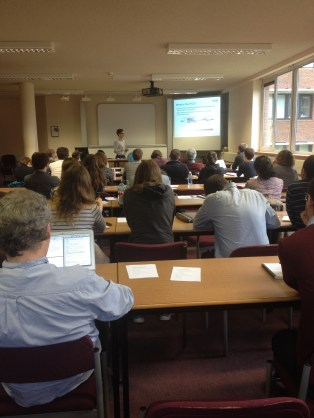 A large audience listening to a Quo Vadis talk