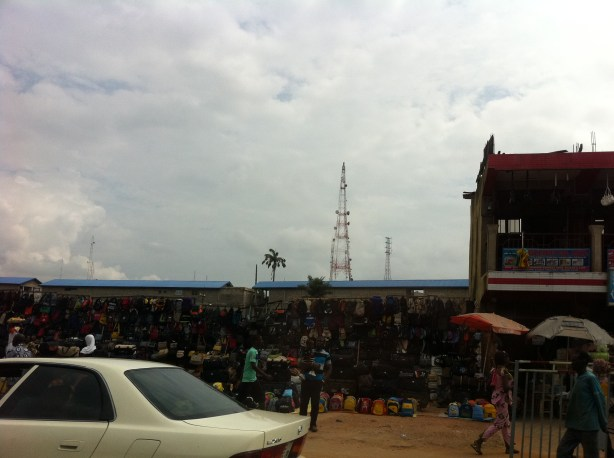 Cell phone towers are a constant site in Kumasi, Ghana.