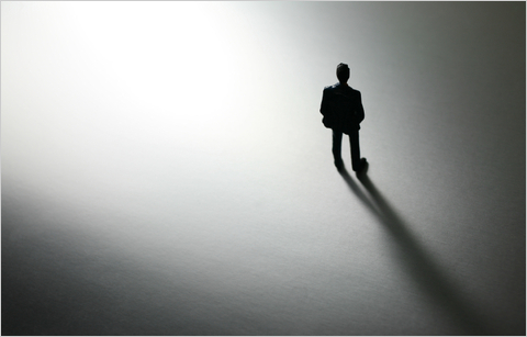 silhouette of a man standing alone.