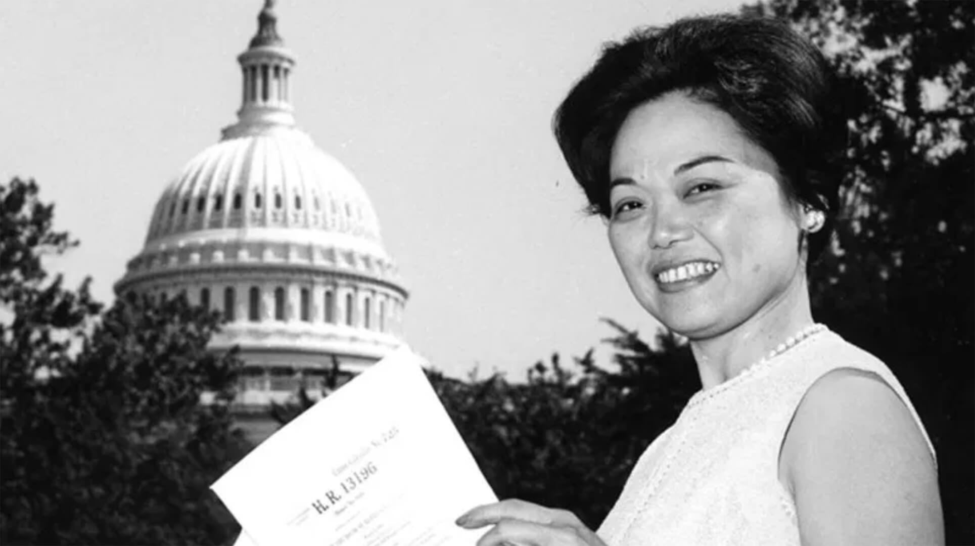A woman is pictured with the U.S. Capitol Building in the background.