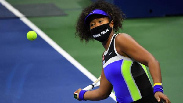 At the 2020 US Open tennis tournament, Naomi Osaka wears a mas honoring Breonna Taylor during her first-round match
