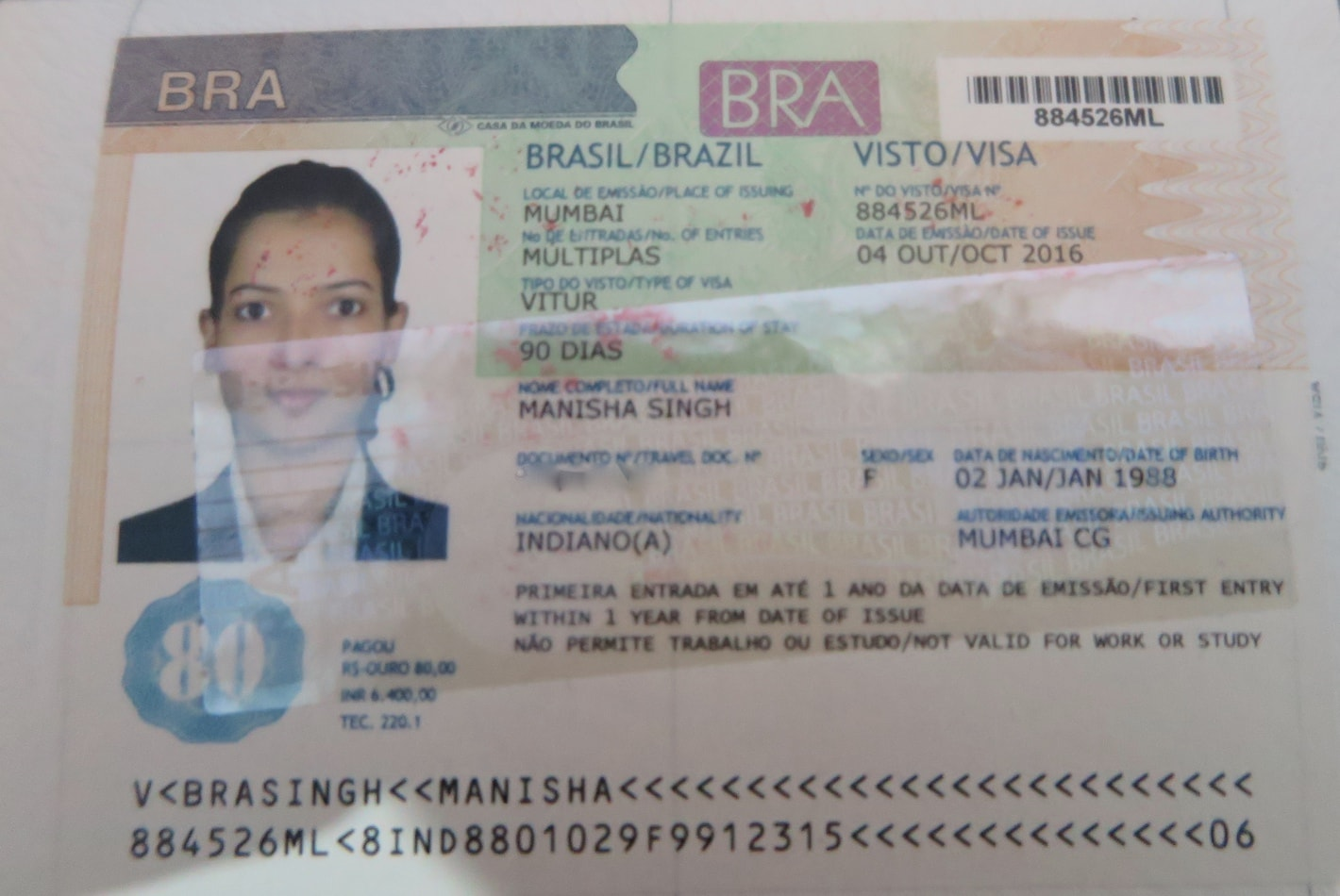 Brazil visa with a woman's image on the left hand side