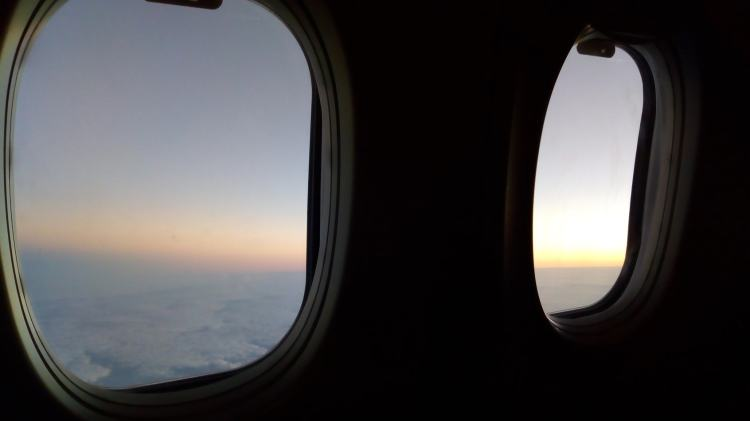 flight window view at dawn