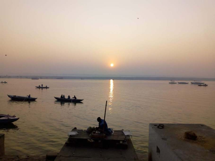 Sunrise over ganga with the silhouette of a man