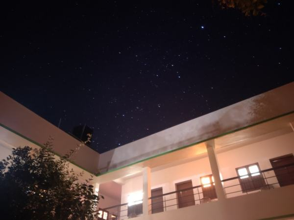 A building against night sky with stars