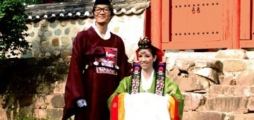 Wedding Photo: Multicultural couple in traditional Korean Hanboks in Busan, Korea