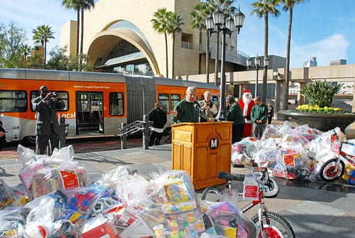 Metro CEO Art Leahy presides over donation of gifts for skid row kids and families. Photo by Luis Inzunza