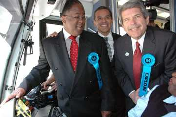 From left, Los Angeles County Supervisor Mark Ridley-Thomas, Mayor Antonio Villaraigosa and County Supervisor Zev Yaroslavsky, with inaugural train operator Carolyn Kelly. Photo: Luis Inzunza