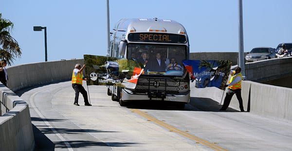 Metro Orange Line bus breaks through banner at dedication event held at the new CHatsworth Station. Yes, that's Mayor Antonio Villaraigosa and Los Angeles County Supervisor Zev Yaroslavsky in the operator's cab. Photo by Gary Leonard.