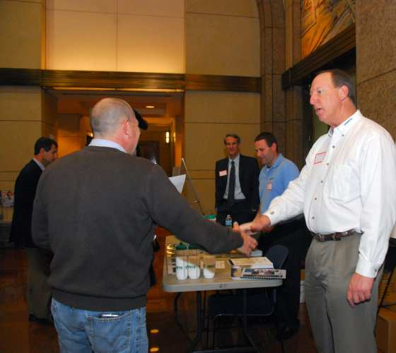 Networking abounds, complete with the tried and true handshake and exchange of business cards.