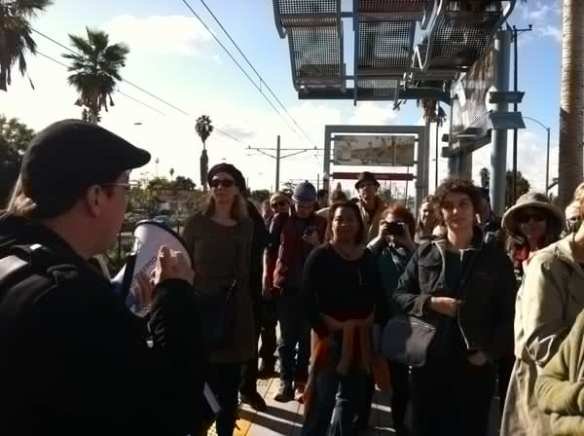 Artist Ronald J. Llanos talking about his artwork on a tour of Expo Line. Courtesy de LaB.