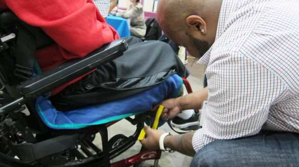 An attendee gets his wheelchair marked for safety straps. Photo by Anna Chen/Metro