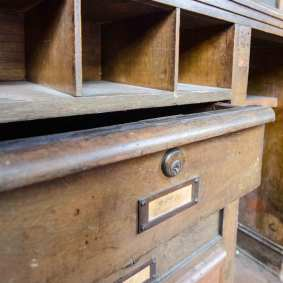 Old cabinets and drawers in the old ticket room.