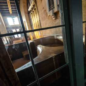 A booth at the Harvey House as seen through a window.