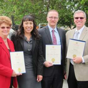 Metro Director Diane DuBois, Chris Newman of the Federal Highway Administration and Caltrans Director Michael Miles receive congressional recognition from the office of Linda Sanchez for the project.