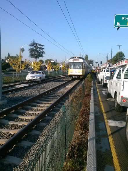 Car blocking the eastbound Expo Line tracks. Due to the location, it was very difficult to get a tow truck in to move the vehicle. Photo: Metro