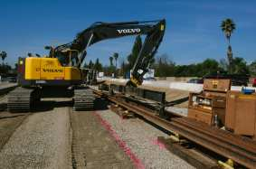 Moving 800-foot sections of rail into place in the 210 median.