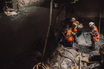 In March, workers extract fossils from the exploratory shaft built for the Purple Line Extension. Photo by Steve Hymon/Metro.