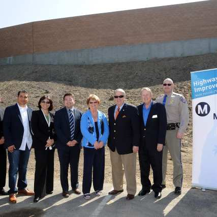 Metro Board Chair Diane DuBois, Board Member Don Knabe, Metro DCEO Lindy Lee join other officials to celebrate the completion of the soundwall project.