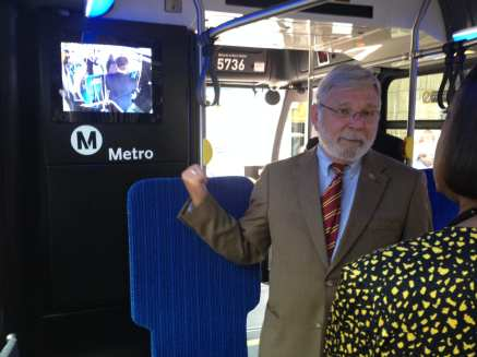 Metro CEO Art Leahy explaining the new security video screen on board a Metro bus in June -- part of a new effort by Metro to deter criminals. Photo: Paul Gonzales/Metro