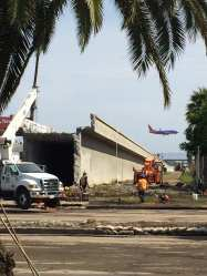 More demolition work along Century Boulevard on Sunday.