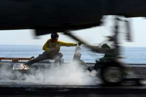 U.S. 5TH FLEET AREA OF RESPONSIBILITY (Feb. 28, 2013) A catapult and arresting gear officer signals for the launch of an EA-6B Prowler from the Wizards of Electronic Attack Squadron (VAQ) 133 aboard the Nimitz-class aircraft carrier USS John C. Stennis (CVN 74). John C. Stennis is deployed to the U.S. 5th Fleet area of responsibility conducting maritime security operations, theater security cooperation efforts and support missions for Operation Enduring Freedom. (U.S. Navy photo by Mass Communication Specialist 2nd Class Kenneth Abbate/Released)