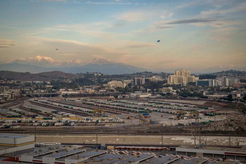 ART OF TRANSIT: Two blimps hovering outside Source World Headquarters window yesterday afternoon. And nice to see some snow on those mountains, too! Photo by Steve Hymon/Metro.